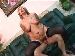 A sexy mature in boots and stockings nailed tubes