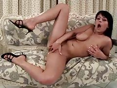 Curvy girl masturbates on the comfy couch tubes