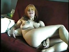 Mature smokes and shows us her titties tubes