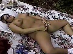 Curvy girl on blanket outdoors fingers pussy tubes