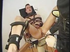 Totally bound guy penetrated by girl tubes