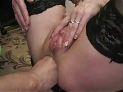 Amateur in stockings fisted up the rear tubes