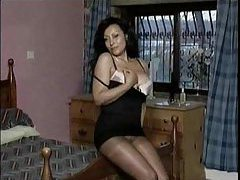 Hot striptease from the lusty old babe in hose tubes