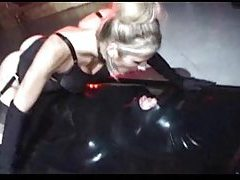 Kinky girl sits on his cock while he is in latex tubes