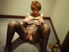 Excited mature babe stripping and sucking tubes