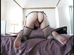Fishnet stockings girl using her favorite toy tubes