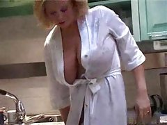 Mother in her kitchen teasing big tits tubes