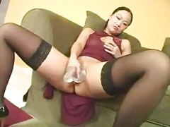 Asian in dress comes inside and toys pussy tubes