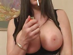 Chubby babe in lipstick smokes and plays with his cock tubes