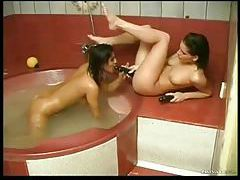 Bathtub hotties use their toys for a thrill tubes