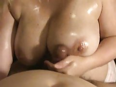 Chubby big tits girl gives oiled up titjob tubes