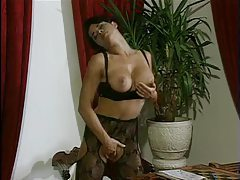 Office babe plays with her big tits tubes