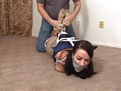 Girl in satin blouse bound and struggling tubes