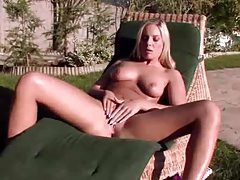 Alone outdoors gently rubbing her sexy cunt tubes