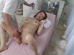 An oiled up girl on the massage table tubes