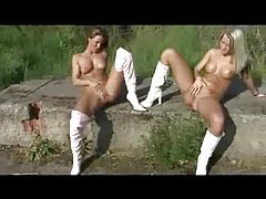 Two babes in boots have lesbian sex outdoors tubes