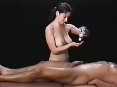 She massages his really big cock tubes