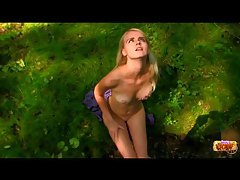 A pretty girl touches and strips outdoors tubes