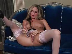 Beautiful girl in pink stockings toys her vagina tubes