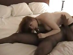 Redheaded wife has great interracial sex in hotel tubes