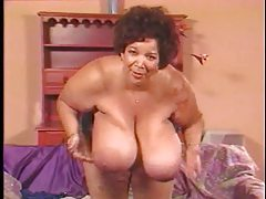 Mature black girl leans over and jiggles tits tubes