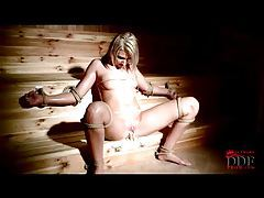 Slick chick tied up in the sauna tubes