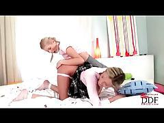 Schoolgirls get into a 69 and eat pussy tubes