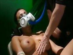 Girl in bondage and gas mask is his plaything tubes