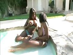 Chubby black girls in bikinis fool around in pool tubes