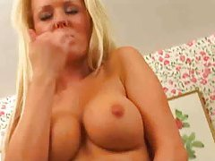 Blonde girl in sexy camo dress teases with cunt tubes