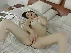 Seductive beauty with a great smile masturbates tubes