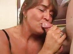 Chubby mature in corset fingers and sucks cock tubes