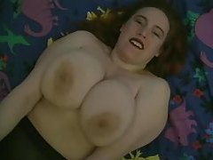 Overweight girl shakes her big titties on camera tubes