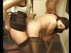 Girls get caned and they must please her strapon tubes