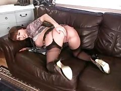 Gorgeous chick in black stockings plays with her pussy tubes