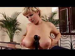 Chick titfucks a bedpost with her knockers tubes