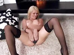 Hot glamorous blonde on her back toys her vagina tubes