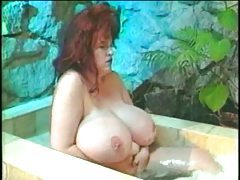 Fat redheaded chick in the bathtub tubes