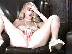 Voluptuous blonde gropes her breasts and plays with her cunt tube