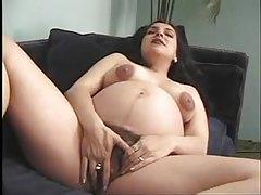 Hairy bush pregnant girl toys her vagina tubes
