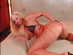 Hot bikini and red fishnets on a sexy blonde tubes