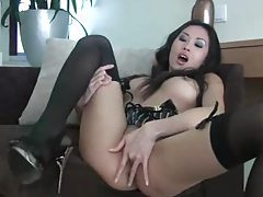 Beautiful Asian in stockings plays with her cunt tubes