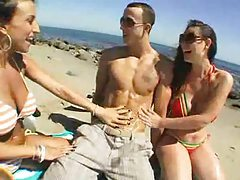 Oiling up two bikini chicks at the beach tubes