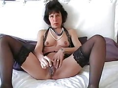 Mature in sexy black stockings toys pussy tubes