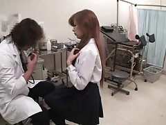 Asian girl visits the doctor for an exam tubes
