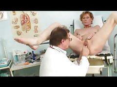 Nude girl visits the gyno for an exam tubes