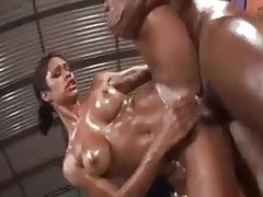 Her body is slick with oil as he fucks her hard tubes