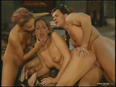 Hot girls sit on both ends of the man tubes