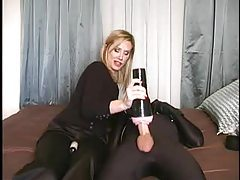 Mistress arouses her submissive with sex toy tubes