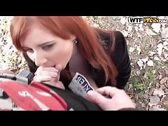 Horny redhead blows two guys in the woods tubes